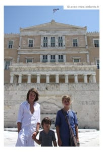Athens with kids, family trip: kids in front of Greek Parliament, on Syntagma Square